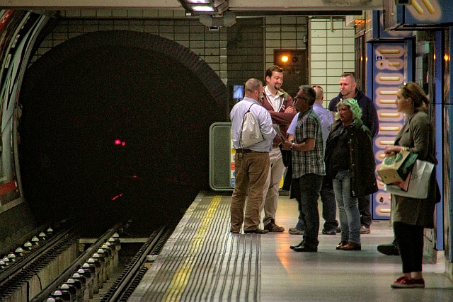 The signal (not always red!) seen in tunnel from Leicester Sq protects Covent Garden station